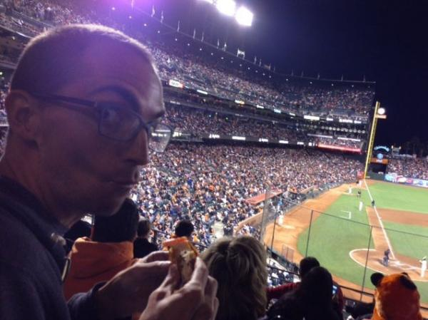 In the sixth inning, Ian realizes there is a baseball game going on around all the food.