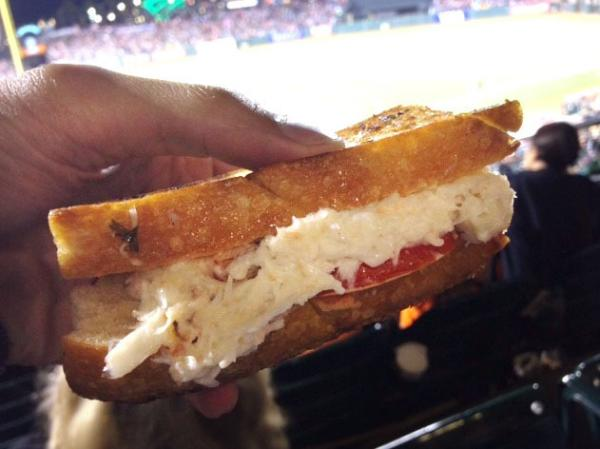 A delicious sandwich and a capable glove, should a foul ball come your way.