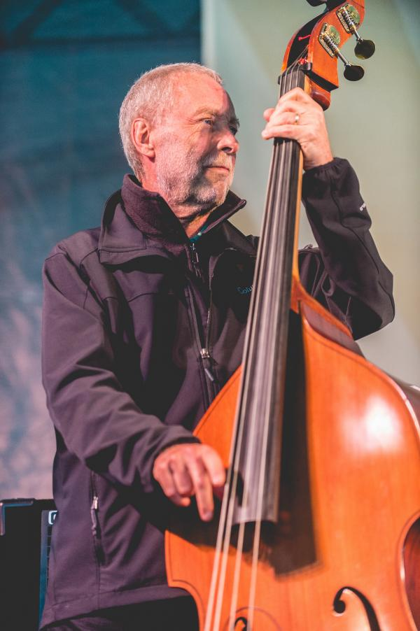 Dave Holland led the quartet Prism on a Saturday when the rain began at daybreak and never relented.