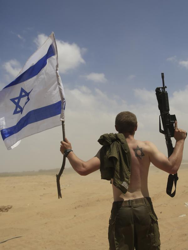 An Israeli soldier from the Paratroop battalion returns from the Gaza Strip on Monday