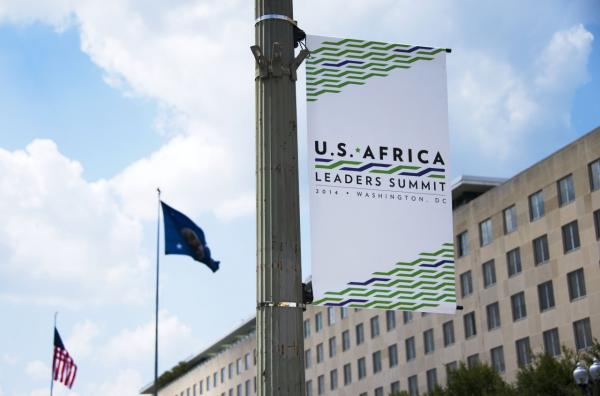 A sign advertising the US-Africa Leaders Summit hangs from a light pole outside the US State Department in Washington, DC, July 31, 2014. (Jim Watson/AFP/Getty Images)
