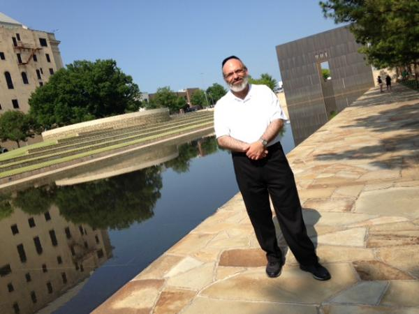 "David Kaufman led a school of orthodox Jewish boys through the Oklahoma City National Memorial. ""A lot of the United States, you could drive from city to city and a lot of it looks the same because it's all commercialized,"" he says. ""You see the same hotels, the same strip malls, the same outfit stores. But then every place has its own unique character and it's interesting to try to find it."" (Peter O'Dowd/Here & Now)"