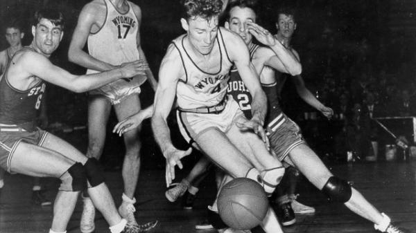 Commentator Frank Deford says part of why we can't do away with college sports is history. Football and basketball have always been tied to college.