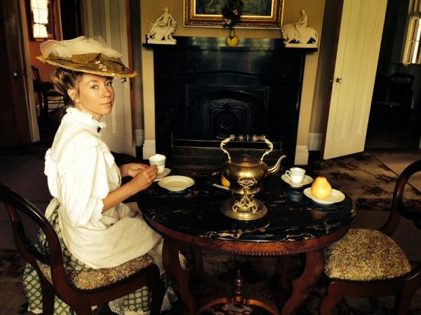 Emily Farra, docent at the Justin Morrill Homestead in Strafford, shows off tea services in the parlor.