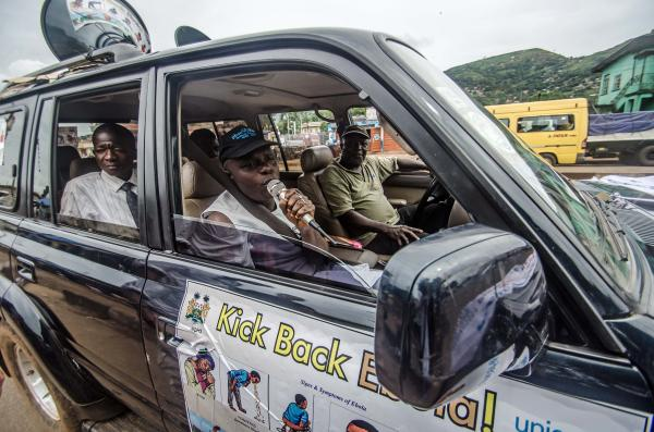 Workers drive around Freetown, Sierra Leone, on Sunday, telling people about the dangers of Ebola.