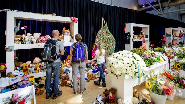 Visitors look at a memorial at Amsterdam's Schiphol Airport on Monday.
