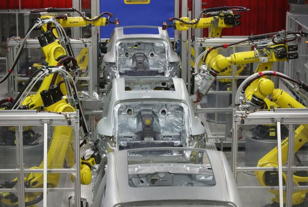 Robots weld the bodies of Porsche Macan SUVs at the new heavily automated Porsche Macan factory at the Porsche plant in February in Leipzig, Germany.   (Sean Gallup/Getty Images)