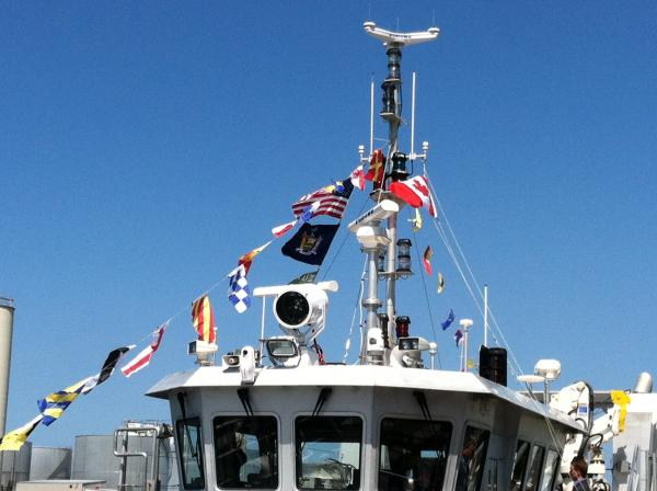 The R/V Kaho flies the flags of the United States, Canada, New York state and the USGS pennant.