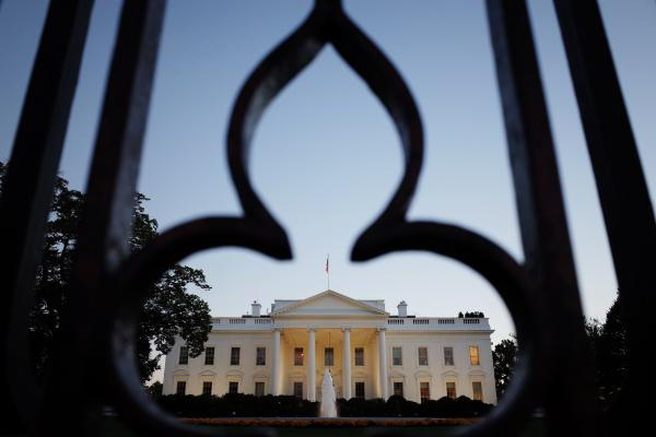 The White House, as seen through the fence on Pennsylvania Avenue.