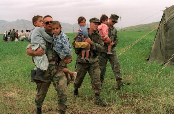 U.S. soldiers carry Iraqi Kurdish children into the Zakho refugee camp in 1991. The U.S. military provided humanitarian relief to Iraqi Kurdish families fleeing Saddam Hussein's army. The rescue operation announced Thursday by President Obama is taking place in the same region.