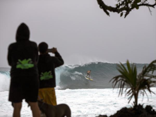 Spectators line the coast Thursday to watch surfers riding large swells generated by Iselle in Pohoiki, on the big island of Hawaii.
