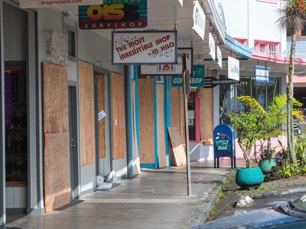 A normally bustling sidewalk on Kamehameha Avenue in Hilo is deserted Thursday, with storefronts boarded up in preparation for Iselle.