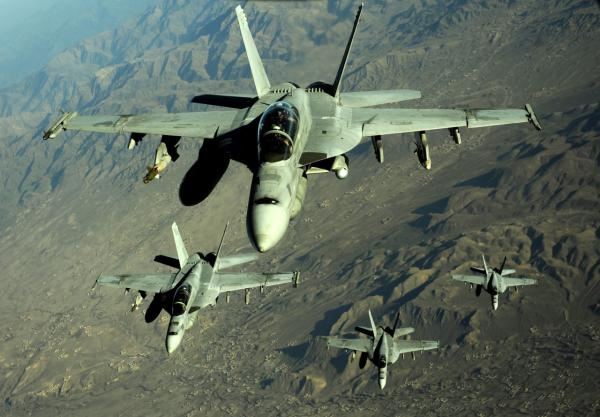 Four U.S. Navy F/A-18 Hornet aircraft fly over mountains in Afghanistan on Nov. 25, 2010.  (DoD photo by Staff Sgt. Andy M. Kin, U.S. Air Force)