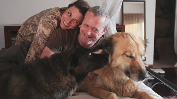 Lourdes Garcia-Navarro with her husband, James Hider, and their dogs Nena (left) and Ursa.