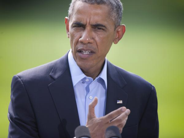 "President Obama speaks on the South Lawn of the White House in Washington, on Saturday. He said the situation in Iraq amounts to a ""long-term project."""