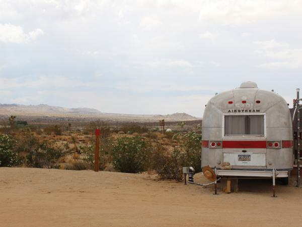 The six Airstream trailers in Landers, Calif., are parked on the edge of the Mojave Desert.