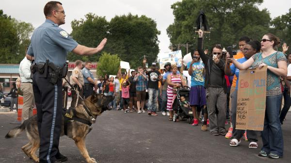 Protesters confront police during a rally protesting the shooting of Michael Brown, 18, by police in Ferguson, Mo. Brown died following a confrontation with police, according to St. Louis County Police Chief Jon Belmar.
