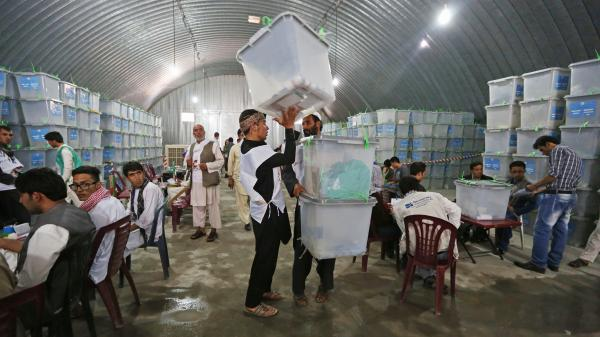 Afghan election workers are auditing all 8 million votes, which fill 23,000 ballot boxes, from the country's June 14 presidential runoff. The process will take weeks and is being slowed by the constant disputes between teams representing the two candidates.