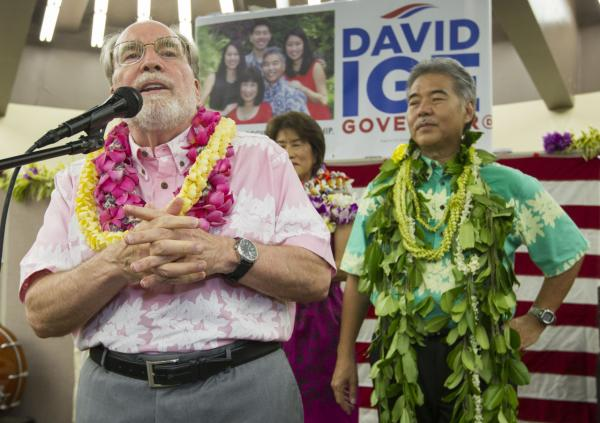 Hawaii Governor Neil Abercrombie, left, addresses the supporters of Hawaii State Sen. David Ige as Ige, right, looks on Saturday, Aug. 9, 2014, in Honolulu. Ige defeated Abercrombie in the state's primary election to win the Democratic Party's nomination.  Abercrombie, who has spent nearly 40 years in Hawaii politics, is the first Hawaii governor to lose to a primary challenger and only the second not to win re-election.   (Eugene Tanner/AP)