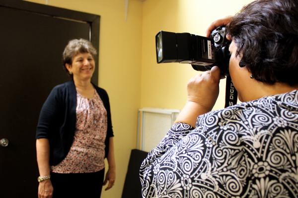 Nancy Ruiz gets her photo taken for her LinkedIn profile at a meeting of the Launch Pad job club in Austin on Aug. 6, 2014.