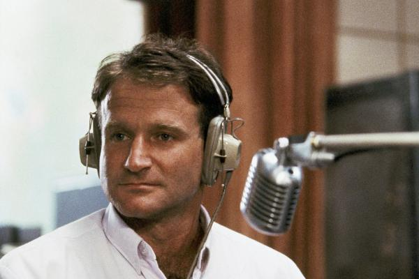 Williams as the wisecracking radio DJ Adrian Cronauer in the 1987 film <em>Good Morning, Vietnam</em>.