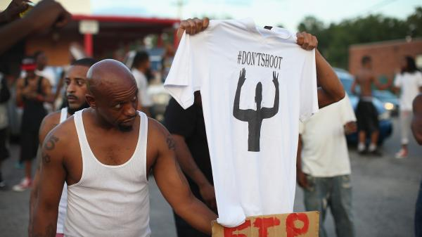 Demonstrators protest the killing of Michael Brown, 18, who was shot and killed by police Saturday in Ferguson, Mo.