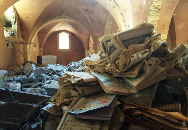 The Omari mosque was badly damaged in the recent fighting in the territory. In the foreground are the remains of Qurans at the mosque, which dates back centuries.
