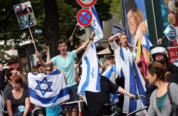 Pro-Israel protesters yell at demonstrators celebrating Al-Quds Day, an event intended to express solidarity with the Palestinian people, on July 25, 2014 in Berlin, Germany. Pro-Palestinian demonstrators marched through Berlin, closely watched by police for any expressions of anti-Semitism and separated from smaller pro-Israel rallies. (Adam Berry/AFP/Getty Images)