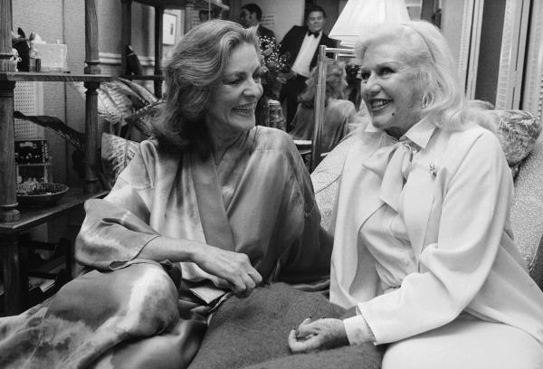 Ginger Rogers, right, visits backstage with Bacall at the Palace Theater in New York in 1981 after seeing Bacall in her Broadway show, <em>Woman of the Year</em>.