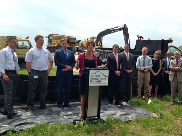 Green Mountain Power President Mary Powell stands with Governor Peter Shumlin, Rutland Mayor Chris Louras and others to announce the groundbreaking of a new $10 million solar farm being constructed on a Rutland landfill.