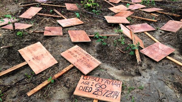 The makeshift markers for graves of Ebola victims lie scattered in a burial site located on swampland, some two hours from the capital city of Monrovia.