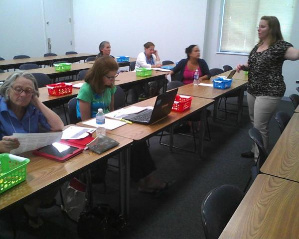 Katie Kolacki gives teachers pointers on how to incorporate the common core in English/language arts courses during a training session last week.