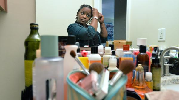 Georgia National Guard Sgt. Jasmine Jacobs uses many hair products to do her daily hair treatment at her home in Atlanta on April 2. Jacobs railed against a military policy that placed heavy restrictions on how women could wear their hair. The policy has been overturned by Defense Secretary Chuck Hagel.