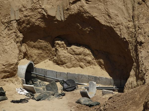 Part of a tunnel exposed by the Israeli military is seen on the Israeli side of the Israel-Gaza border on Thursday, as a five-day extension of a cease-fire deal goes into effect.