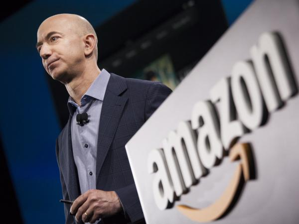 Amazon, whose CEO Jeff Bezos is seen here, has launched a new store and staffed pickup center with Purdue University.