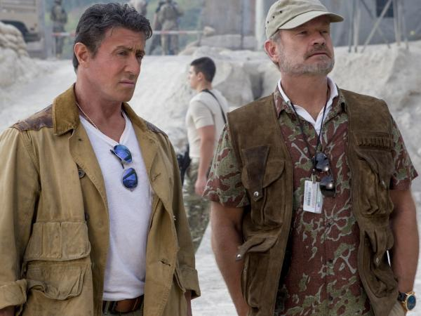 Kelsey Grammer (right) plays Bonaparte, a retired mercenary who assists Sylvester Stallone's Barney with recruiting new members of the Expendables team.