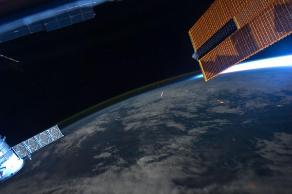 A Perseid meteor streaks through the Earth's atmosphere, as seen and photographed by astronaut Ron Garan while aboard the International Space Station on August 13, 2011. (NASA)