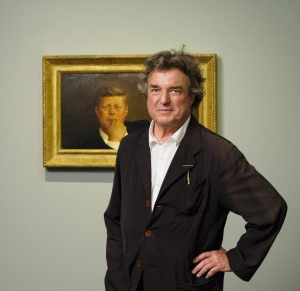 Jamie Wyeth poses in front of his portrait of John F. Kennedy. (Courtesy/Museum of Fine Arts)