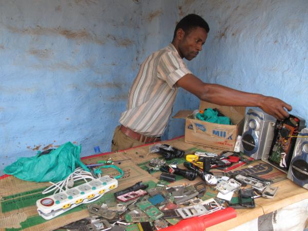 Ali Daud Omar will repair your cell phone for $6. He's one of the refugees benefiting from the Ugandan government's right-to-work policy.