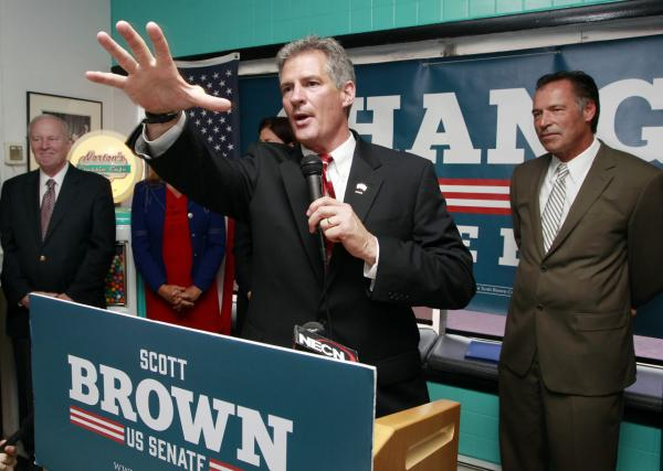 Republican U.S. Senate candidate Scott Brown speaks after getting the endorsement from former New Hampshire governors, Steve Merrill, far left, and Craig Benson, far right, and U.S. Sen. Kelly Ayotte, not seen, in May. (Jim Cole/AP)