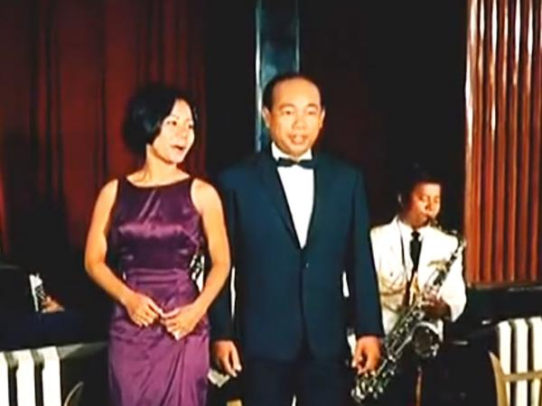 Cambodian psychedelic rock star Sinn Sisamouth (right) performs in the 1966 movie <em>Apsara</em>.