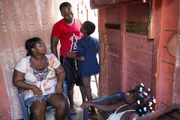 Anderson with his parents, Adrienne Jean Pierre and Roudy Desir, and sister, Rosaura Desir, in their home in San Pedro de Macoris. Under a new law, Anderson and his parents fall in one category because they were born in Haiti; his siblings fall in another category because they were born in the Dominican Republic.
