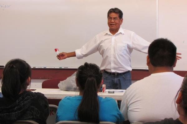 Tobacco prevention specialist Rob Carr speaks to a group of youth and elders at the Red Rock Chapter of the Navajo Nation in New Mexico.