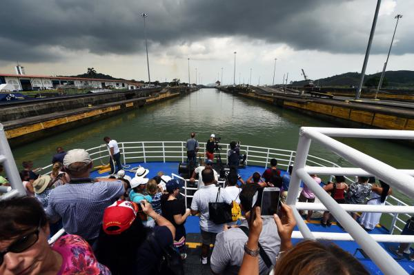 Tourists take pictures of Pedro Miguel Locks during a boat trip through the Panama Canal, on August 12. August 15 marks the 100th anniversary of the Panama Canal, considered to be one of the 20th century's marvels of engineering and through which goes five percent of the maritime world trade.(Rodrigo Arangua/AFP/Getty Images)