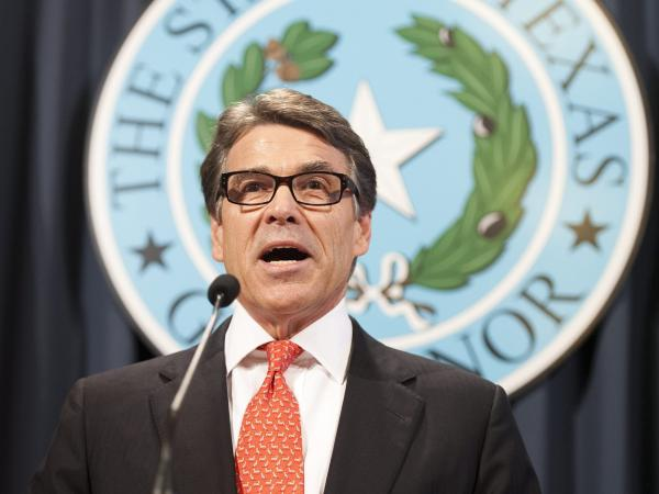 Texas Gov. Rick Perry makes a statement regarding his indictment on charges of abuse of power at the Texas state capitol, in Austin, Texas, on Saturday.