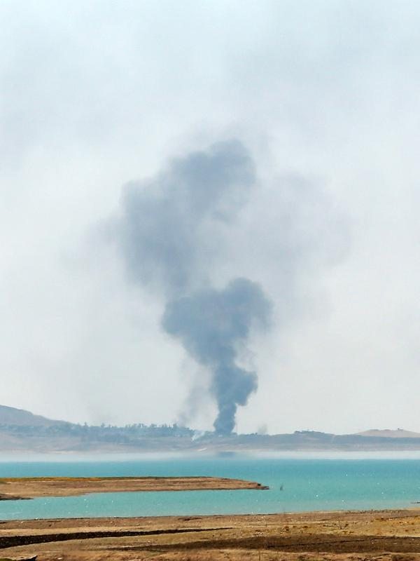 Smoke rises during airstrikes targeting Islamic State militants at the Mosul Dam outside Mosul, Iraq, on Monday. Kurdish forces say they have retaken the dam, but the militants insist they still have control.