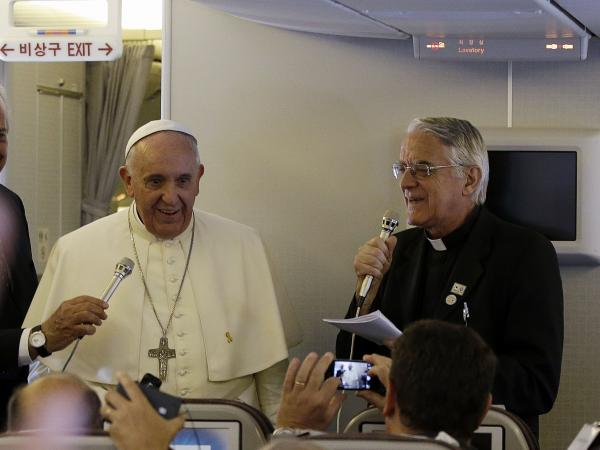 Pope Francis meets the media during an airborne news conference on his journey back to Rome from Seoul, South Korea, on Monday.