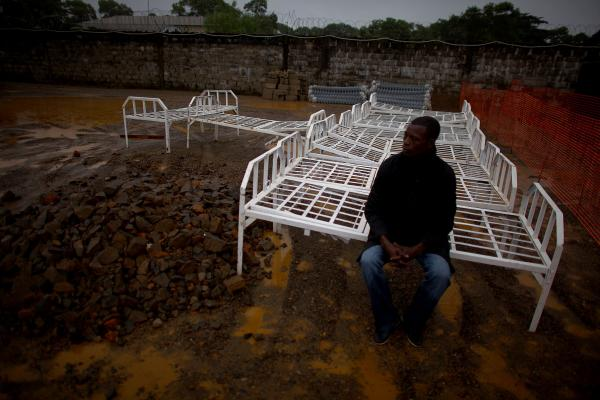 A man sits on a bed that will be part a new Ebola treatment center in Monrovia, run by Doctors Without Borders.