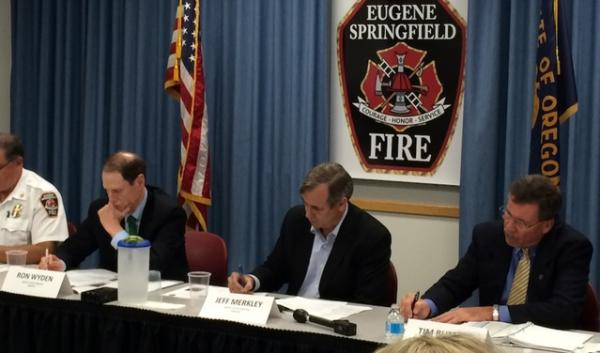 Eugene Fire Chief Randy Groves, Senator Ron Wyden, Senator Jeff Merkley, and Tim Butters, deputy administrator at the Pipeline and Hazardous Materials Administration, lead a discussion on oil train safety in Eugene, Oregon.