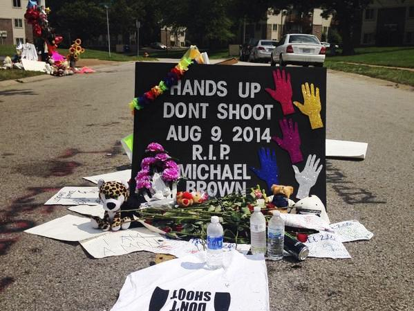 A makeshift memorial to Brown near the spot where he was shot and killed by a police officer.